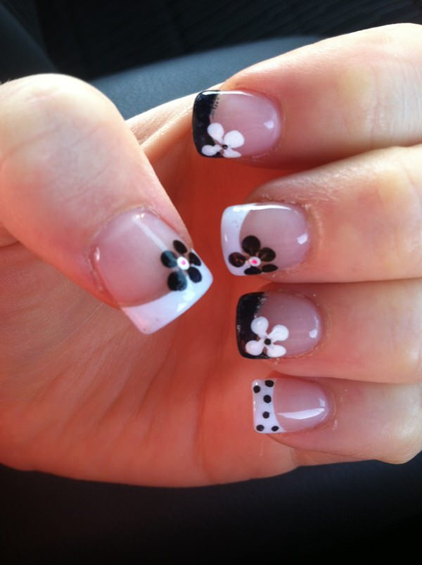 Fun, flowery nails are wonderful for the summer season. The French manicure  featured in the picture below is fabulous. The blend of black and white is  ... - 42 Stunning French Nails You Can Go Crazy Over......