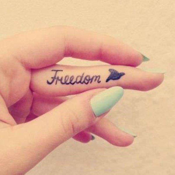 49-Font-and-bird-finger-tattoo