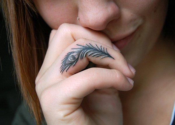 9-Peacock-finger-tattoo
