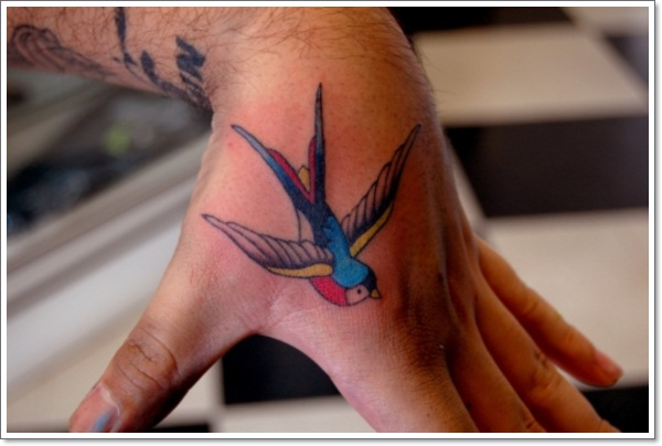 A-swallow-tattoo-on-the-hand-that-can-symbolize-travel-loyalty-and-patriotism